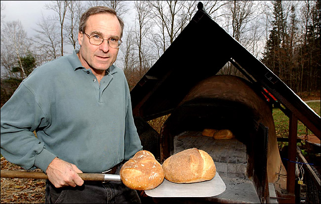 Dan Wing with his mobile (trailered) oven -- and bread