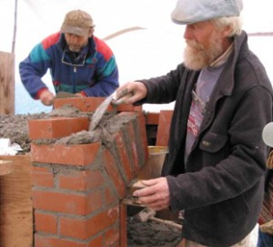 Alan Scott (front) at work on an oven (photo courtesy Ovencrafters)