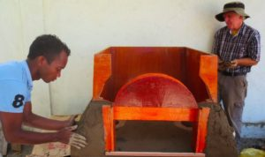 Jon (R) and a helper forming the kiln. The Ahiasun factory provides employment for disabled folks.
