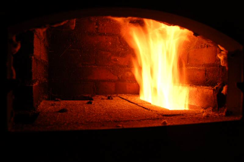 The opening in the oven floor acts as a throat where the fire leaps out of the firebox. Photo Credit, Norbert Senf, MHA