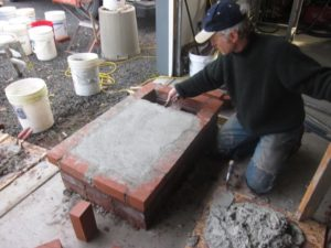 the mortared edge bricks provided a screed for a bed of mortar